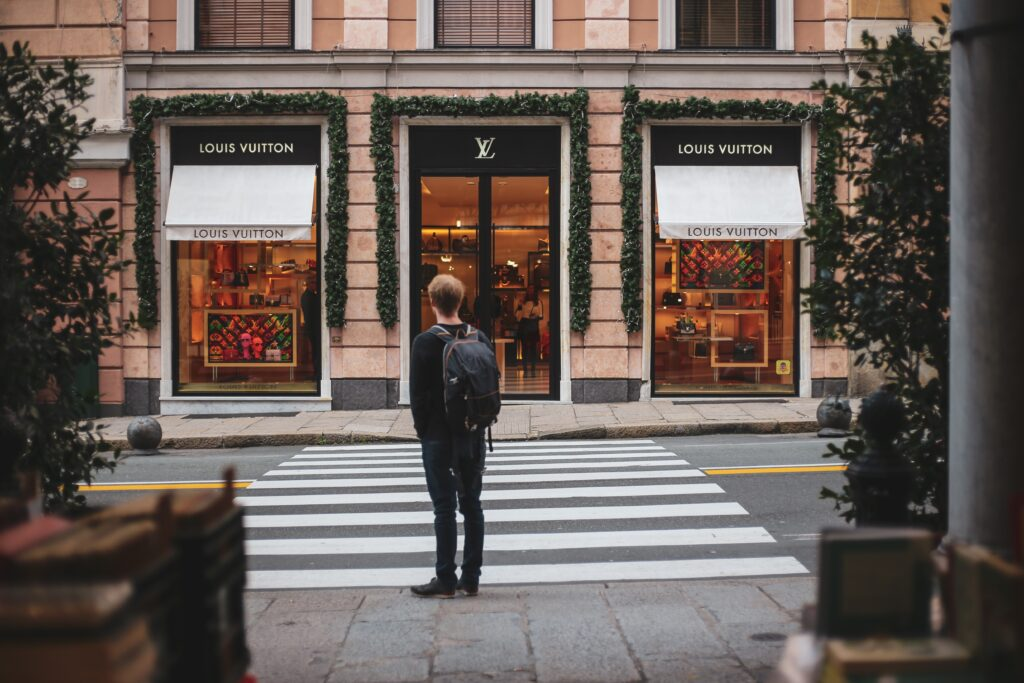 a man in front of louis vuitton store russian translations for luxury brands